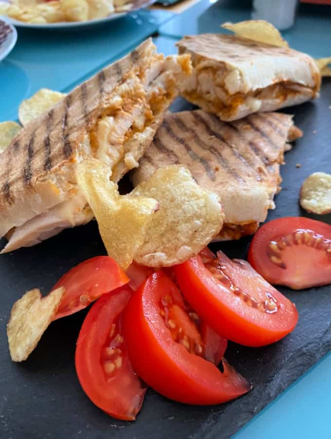 Cheesy Chicken Panini Sandwich. Grilled Chicken sandwiches filled with melting cheese, using leftover cooked chicken. Serve warm for lunch or supper.