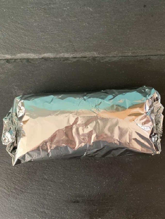 Cheesy Chicken Panini Sandwich showing panini wrapped in foil for the oven