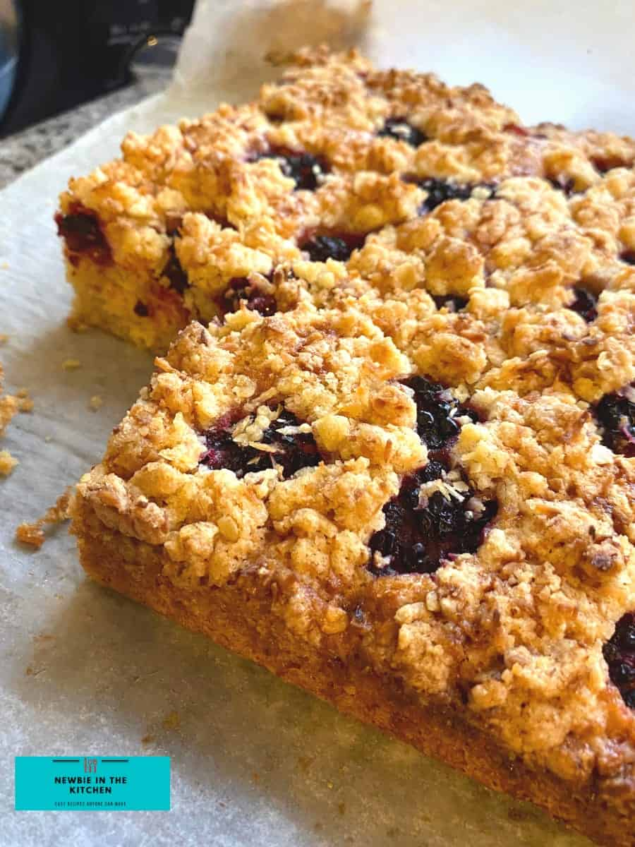 Easy Homemade Raspberry Crumb Bars. Quick and easy made from scratch recipe with a delicious vanilla streusel crumble topping. Great tasting sweet & tangy cake. Great for dessert or tea time