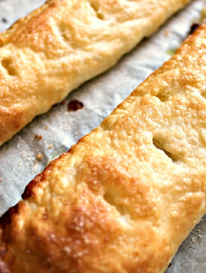 Easy Mini Cherry Pies. Crispy puff pastry filled with cherry preserve, these little hand pies are quick and easy to make. Delicious served warm with ice cream for dessert or on their own as a snack