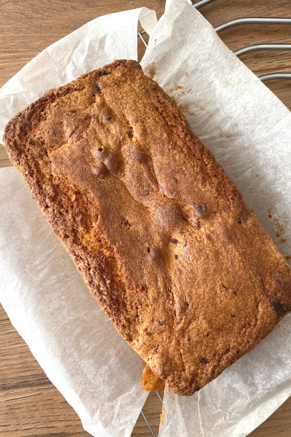 Simple Raspberry Pound Cake and White Chocolate Topping on cooling rack