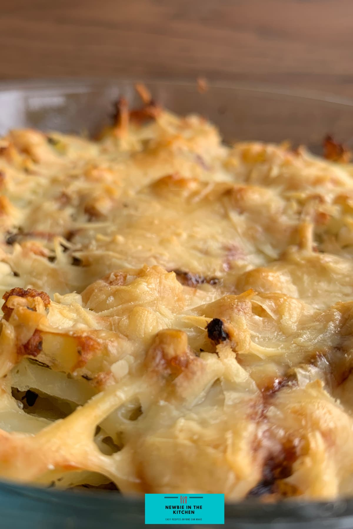 Cheesy Oven-Baked Garlic Potatoes. A simple, easy side dish recipe, with fluffy potatoes, cheese, and onions, baked in a tasty garlic and herb mix. The perfect cheesy potato bake!