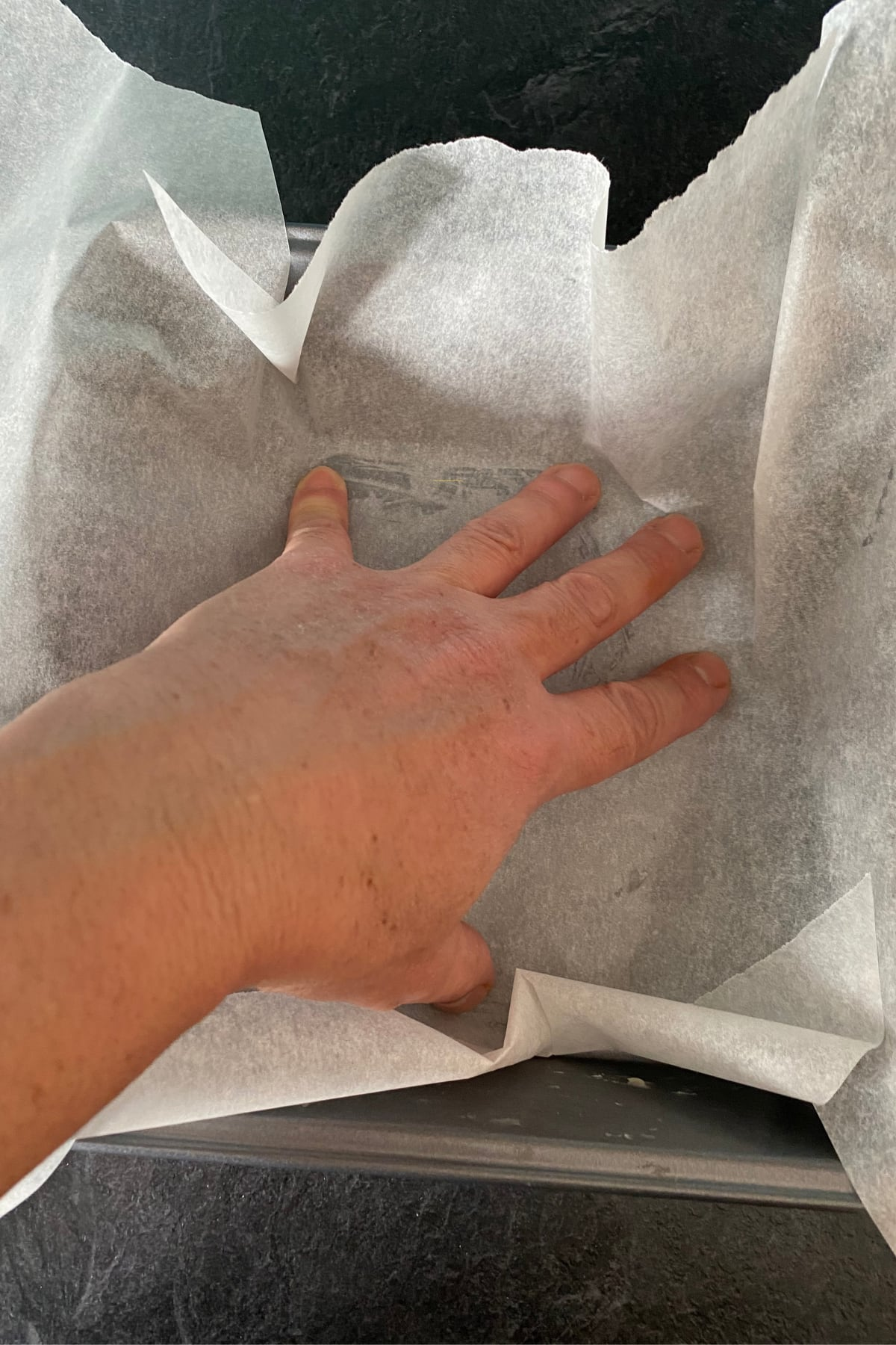 How to Line A Square Baking Pan With Parchment Paper, transfer paper to the pan