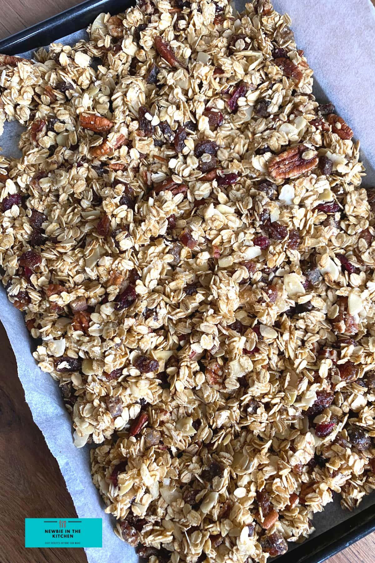 Spread granola on baking sheet